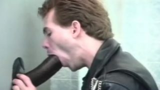 Gay glory hole cock sucking on the toilet