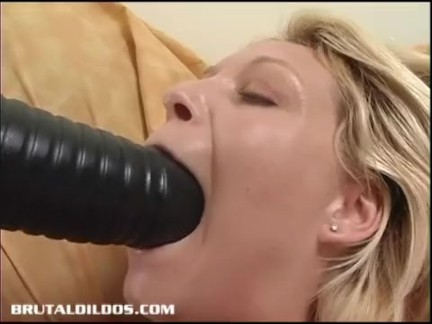 Busty blonde punishes her pink pussy with a huge dildo